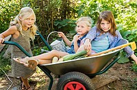 Girls in a wheelbarrow