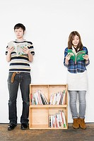 Young man and woman reading books (thumbnail)