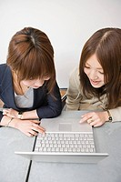 Young women looking at laptop