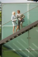 Germany, business people standing on stairs