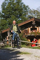 Austria, Karwendel, Senior man biking