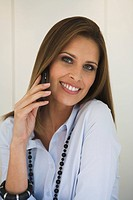 Business woman using mobile phone, portrait