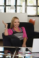 Young business woman in office, laughing
