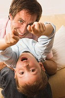Father and son 4_5, fooling about, boy pointing with fingers