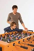 Father and son 4_5 playing tabletop soccer