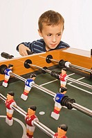 Little boy 4_5 playing tabletop soccer