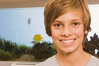 Teenage boy 13_14, smiling, portrait