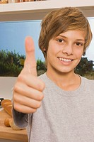 Teenage boy 13_14 smiling, thumbs up, portrait