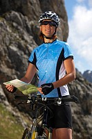 Germany, Bavaria, Karwendel, Woman with mountain bike and map