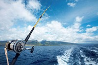 Fishing boat with a spinning rod in the ocean. Hawaii, Maui, USA