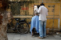 Street barber in the old town of Hanoi.