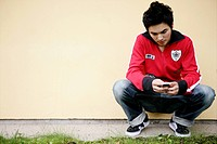 Boy, stylish, attractive, looking, cell phone, tee (thumbnail)