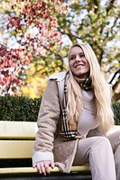 woman, sitting, bench, park, relaxed, smiling, fem