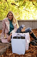 woman, outdoor, resting, shopping bags, park, youn