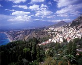 View over the popular tourist resort of Taormina on the Sicilian east coast with Mount Etna in the distance
