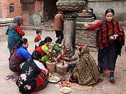 Nepal, Kathmandu Valley, Bhaktapur, women making religious ritual offerings