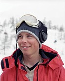 Male smiling, wearing headphones