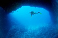 Diver at wide bottom Hole of Blue Hole Cave, Micronesia, Palau