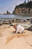 Little boy playing in the sand, Simpson Beach, Oregon