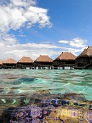 Overwater bungalows and coral in lagoon, Hilton Moorea, Tahiti. No PR