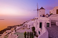 View from the Village of Oia perched on steep Cliffs, at Sunset, Santorini, Greece.
