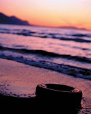 Surf on beach at sunset