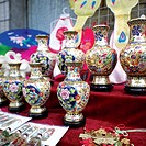 Beijing, People´s Republic of China. Street vendors sell vase