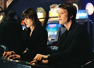 movie, Slumming, DEU 2006, director: Michael Glawogger, scene with: Pia Hierzegger and August Diehl, drama, half length, fruit machine,