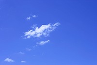 Scattered cumulus clouds in blue sky