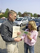 Seller and customer shaking hands, second hand car market, purchase contract