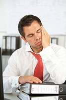 Man in the office feeling dull
