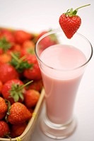 Strawberry milk shake with fresh strawberries