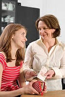 Female teenager receiving pocket money