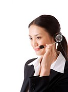 Businesswoman wearing headset, side view