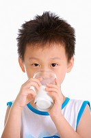 Boy drinking milk, close up, portrait