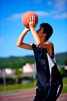 Teenage boy preparing to throw basketball