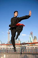 Young man doing martial arts on the Bund