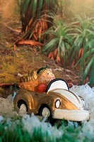 Figurine driving car outdoors