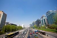 Traffic on road between buildings