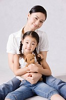 Young mother holding daughter