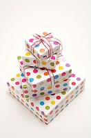 Five wrapped gifts with ribbons