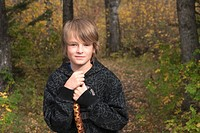 Ten_year_old boy with walking stick on trail in woods, Lake Katherine, Riding Mountain National Park, Manitoba