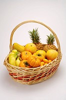 Close_up of a stack of yellow fresh fruits and vegetables in a basket