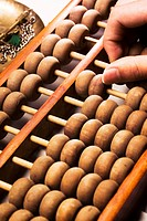Man using Chinese traditional calculator abacus