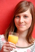 Teenage girl orange juice