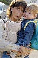 Little boy going to school with mummy