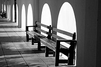benches await visitors along arched, covered walkway