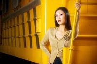 A stock photo of an Asian woman on an industrial location