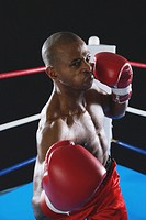 African boxer wearing red Boxing gloves ready to punch (thumbnail)