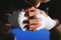 Boxer's hands and knuckles tied with bandage
